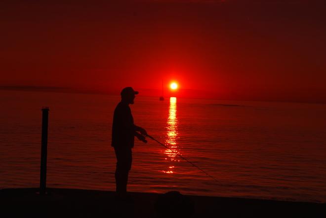 Setting sun & fisherman Kincardine, ON