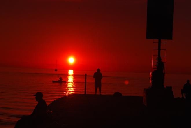 Sunset...at the pier w/ fisherman Kincardine, ON