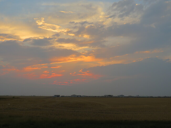 The clouds that swallowed the sun, Queen St, North Weyburn, SK S0C 1X0, Canada