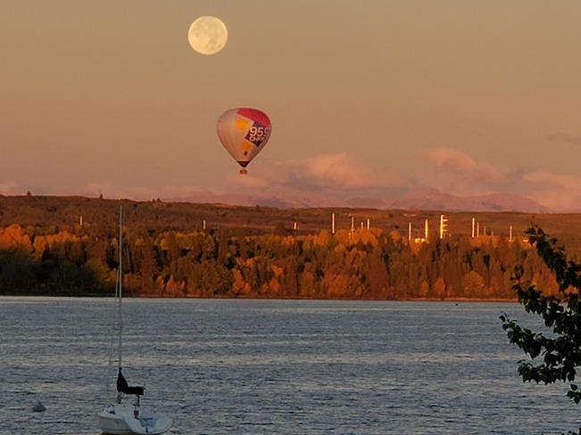Fullmoon a hot air balloon over glemore resovoir Calgary, AB