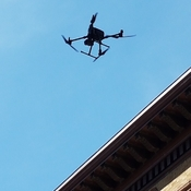 Drone Hovering Under Blue Sky