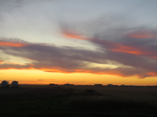 The Sun has Set, but the Clouds Still Reflect at 6:48 p.m. Queen St, North Weyburn, SK S0C 1X0, Canada