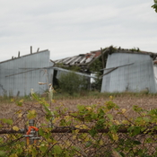 Slow-motion demolition of an old agricultural bldg