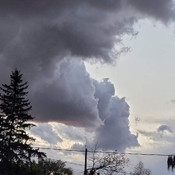 Faces in the clouds warning a storm