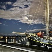 Sailing moon over sailing ships