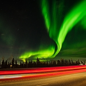 Northern Lights and taillights from a car.