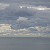 Cloud deck breaking up out over Lake Ontario and New York State