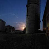 Evening barn chores under the full moon.