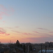 Clouds to the southeast reflect various stages of the dawn over Weyburn