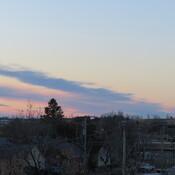 Brush strokes at dawn over Weyburn